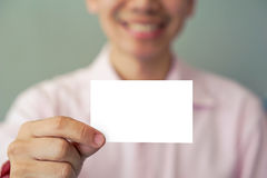 Man holding business card Stock Photo