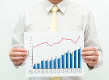 Business chart. Man holding a business financial graph and chart Royalty Free Stock Images