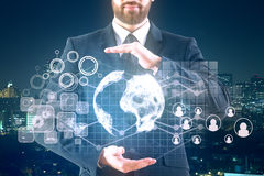 Man holding business hologram Stock Photography