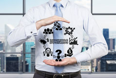 Man holding business icons Royalty Free Stock Image