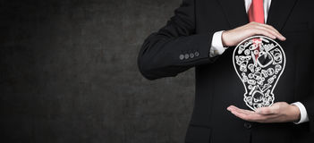 Man holding business icons Royalty Free Stock Photo