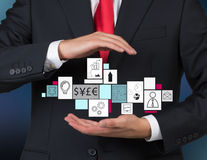 Man holding business symbol Stock Images