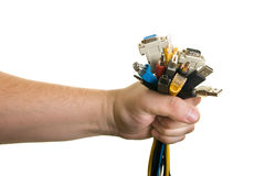 Man holding cables. Man holding bunch of cables Royalty Free Stock Photos