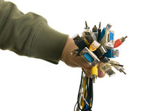Man holding cables. Man holding bunch of cables Royalty Free Stock Photo