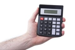 Man holding a calculator in his hand. Man holding a calculator with a blank digital display in his hand isolated on white in a conceptual financial or Stock Photography
