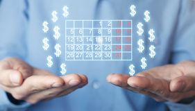Man holding calendar and dollar signs. stock images