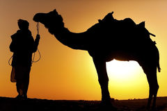 A man holding a camel Royalty Free Stock Photography