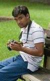 Man holding camera Stock Photos