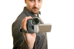 Man holding a camera. Man shoots with a camera Stock Photography