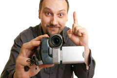 Man holding a camera. Man shoots video with a camera Stock Image
