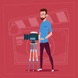 Man Holding Camera On Tripod Modern Video Blogger Filming Popular Vlog. Flat Vector Illustration Stock Image