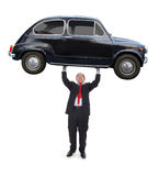 Man holding a car. Man holding a black car - Conceptual image on will power and success Stock Photography