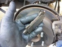 Man holding car brake shoe Stock Image