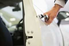 Man holding a car door handles Royalty Free Stock Images