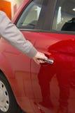 Man holding a car door handles Royalty Free Stock Photo