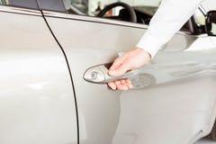 Man holding a car door handles Stock Image