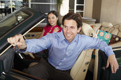 Man Holding Car Key With Woman Beside Him In Convertible Royalty Free Stock Photography