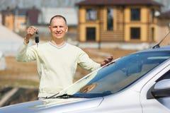 Man holding car keys Stock Image