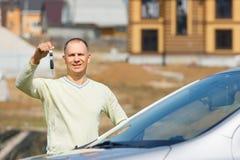Man holding car keys Stock Photo