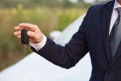 Man holding car keys Royalty Free Stock Image