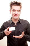 Man holding a card Stock Image