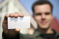 Man holding card Royalty Free Stock Images