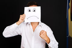 Man holding card with a angry face Royalty Free Stock Image