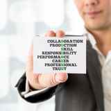 Man Holding Card with Business and Related Words Stock Photos
