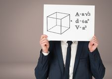 Man holding card with equations geometry graphic drawings. Digital composite of Man holding card with equations geometry graphic drawings Royalty Free Stock Photography