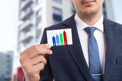 Man holding card presenting swot method. As initials for strengths weaknesses opportunities threats in business strategy concept royalty free stock photo