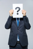 Man holding card with question mark Stock Photography