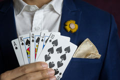 Man holding card royal straight flush Royalty Free Stock Images