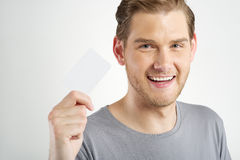 Man holding card Stock Images