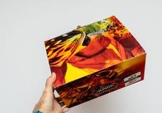 Man holding cardboard box containing new Alpina Bike helmet Royalty Free Stock Image