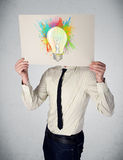 Man holding a cardboard with paint splashes Stock Image