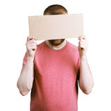 Man holding a cardboard sign Royalty Free Stock Photography
