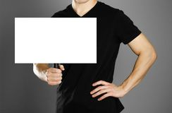 Man holding a cardboard sign with a handle. Close up. Isolated background.  royalty free stock photo