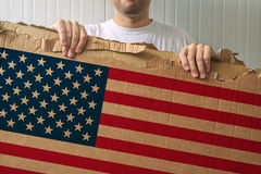 Man holding cardboard with USA flag printed Royalty Free Stock Photo