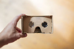 A man holding a cardboard VR headset POV Royalty Free Stock Images