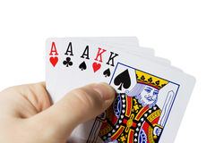 Man holding cards in hand. Playing poker Royalty Free Stock Images
