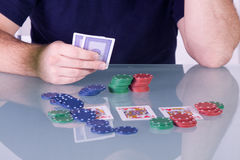 Man Holding Cards on the Table in Texas Hold'em Stock Image
