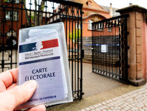 Man holding Carte Electorale - voter`s card French voter registr. STRASBOURG, FRANCE - MAY 7, 2017: Man holding Carte Electorale - voter`s card French voter royalty free stock image