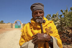 A man holding a carved cross, Ethiopia Stock Image