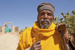 A man holding a carved cross, Ethiopia Stock Photo
