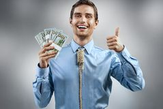 Man holding cash money and showing thumb up. royalty free stock photo