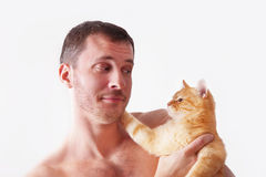 Man holding a cat on his hands Royalty Free Stock Photos