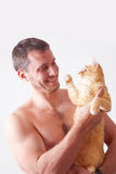 Man holding a cat on his hands Stock Images