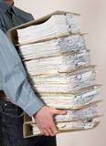 Man holding catalog of documents. Man holding catalog of white documents in his hands Stock Photos