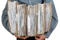 Man holding catalog of documents. Man holding catalog of white documents in his hands Stock Photo
