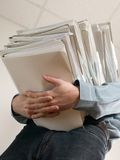 Man holding catalog of documents Stock Photo